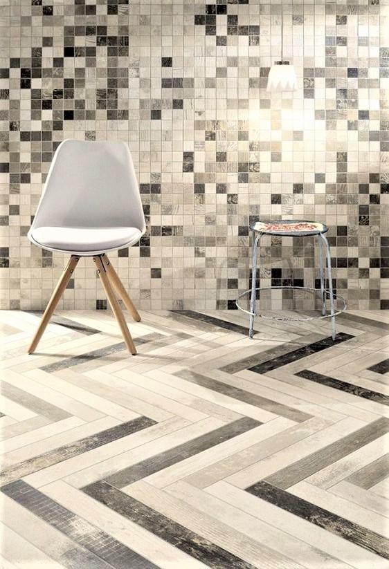 pavimento e rivestimento in gres colorato in grigio e bianco con sedia